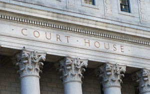 bigstock-The-words-Court-House-outside--21898370