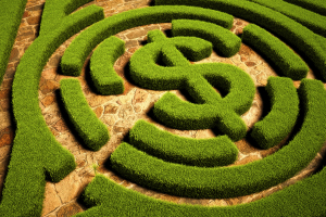 Hedgerow maze leading to a dollar symbol